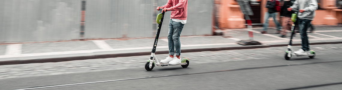 [Photo: E-Scooter in urban environment]